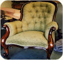 Victorian button back armchair with out turned scrolled arms, stuffed with finest quality horse hair and upholstered in John Singleton green chenille