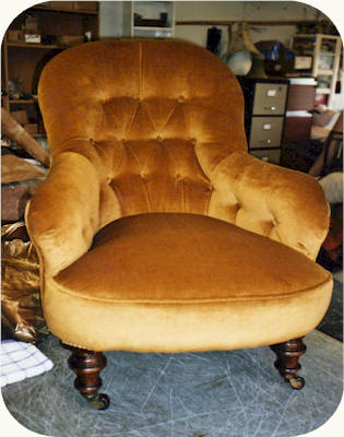The Chair Was Finished In Gold Velvet With Piping.