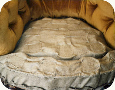 The seat is sprung with a separate edge to create better shape. Hessian layer, stitched.